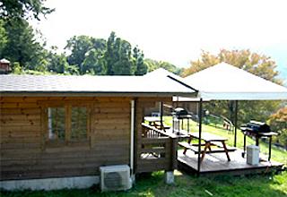 パディントンベア・キャンプグラウンドのログキャビン・デラックステラス付の写真